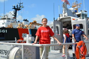 Joslyn on a Coast Guard boat at Galveston Station