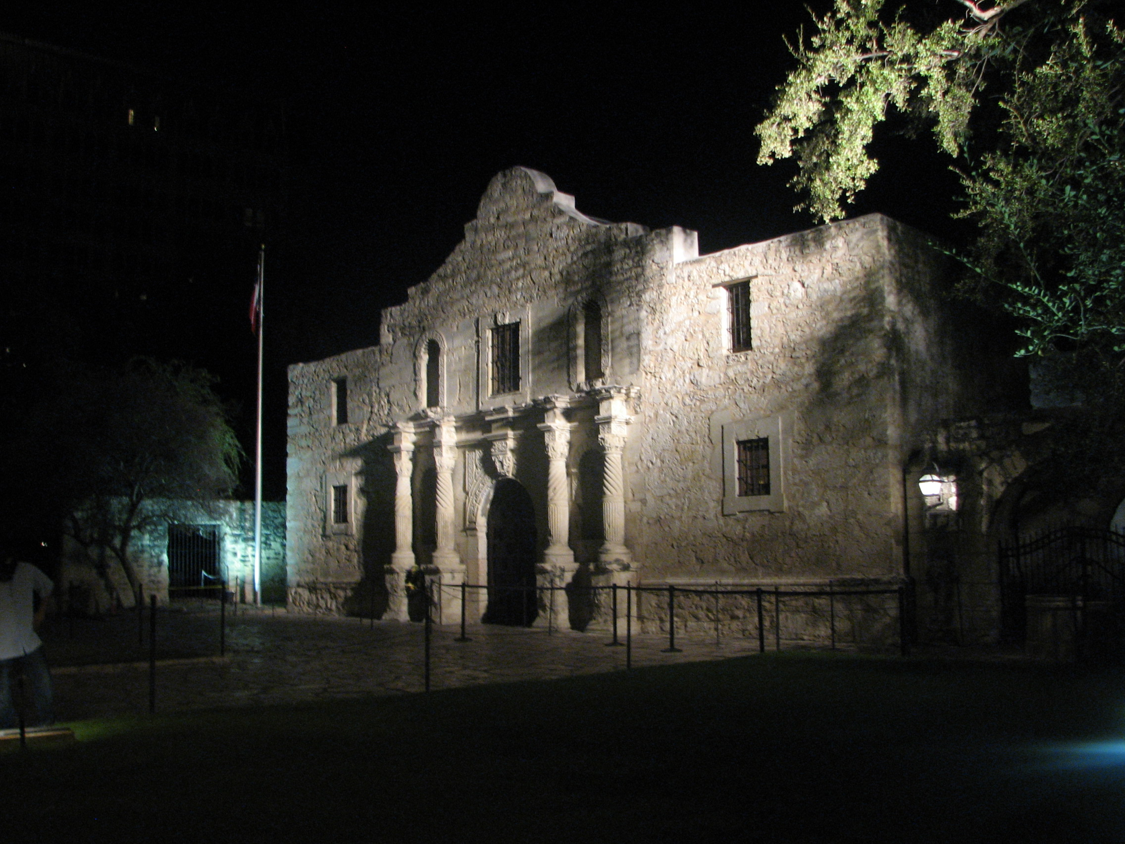 The Alamo with lights on it at night